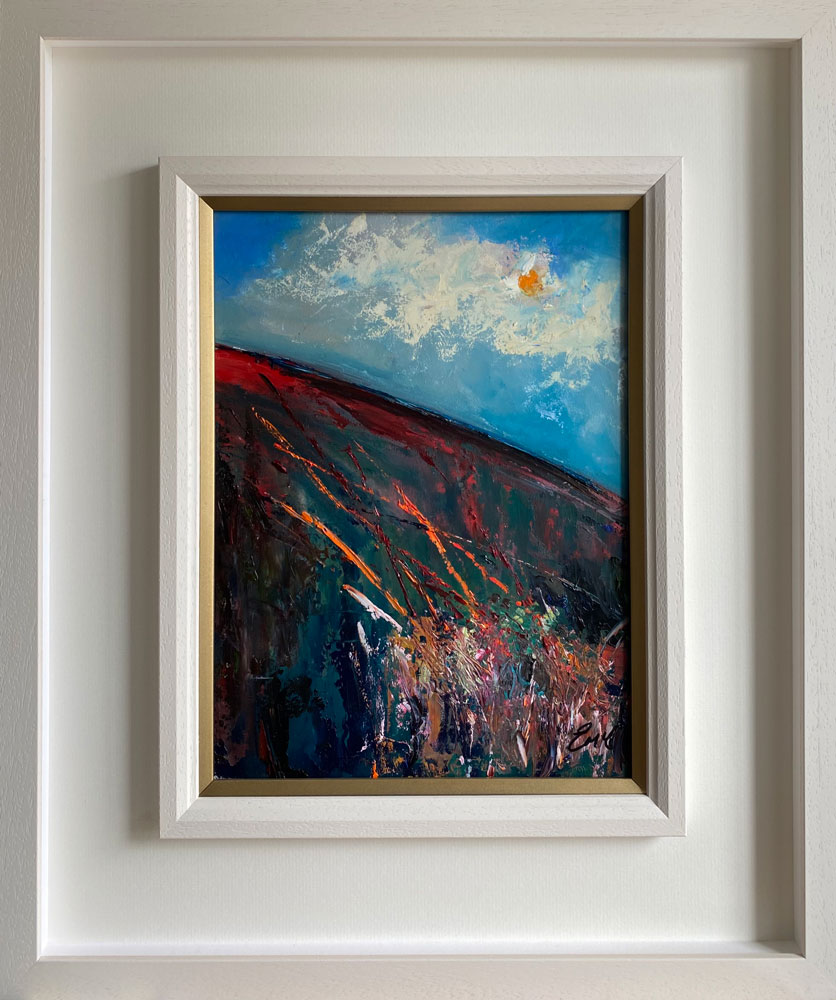 a medley of colour in a white wood frame